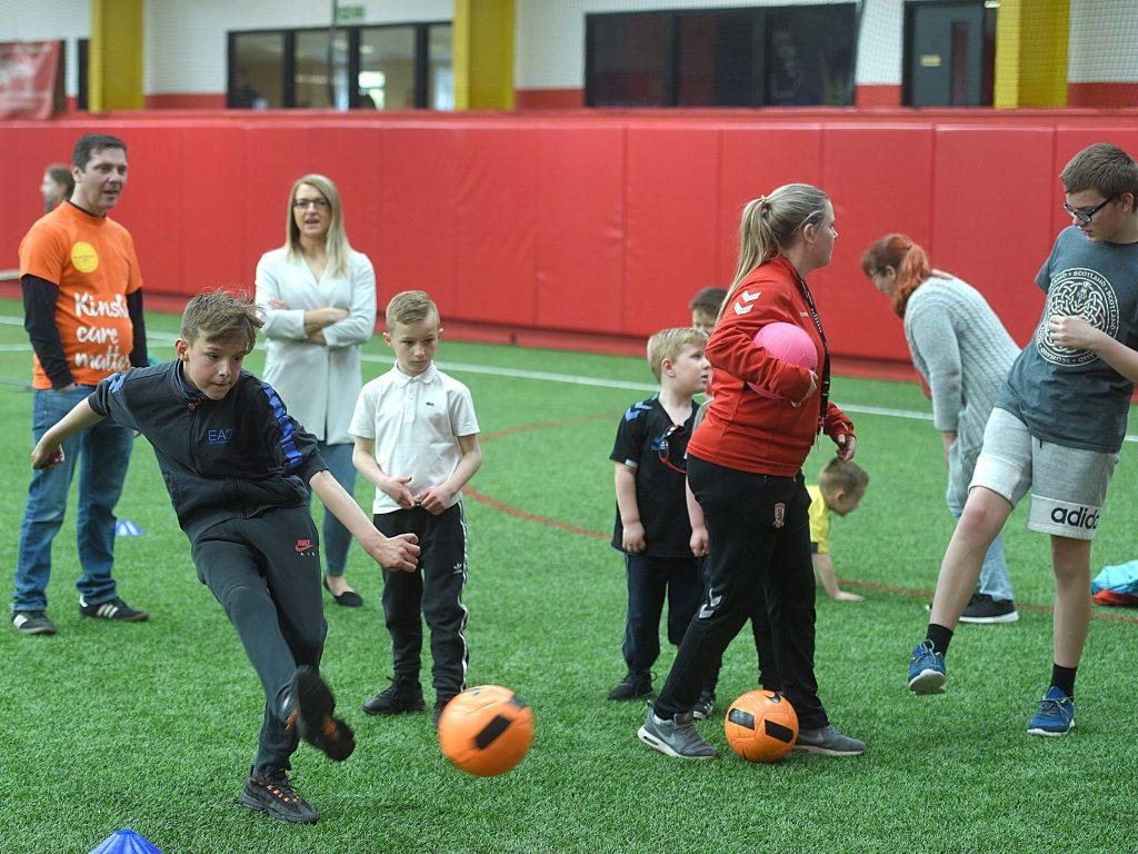 Group playing football at Kinship Active event