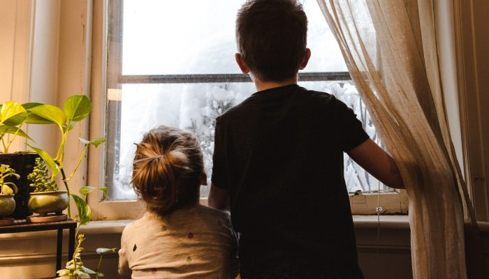 Kids looking out of a window